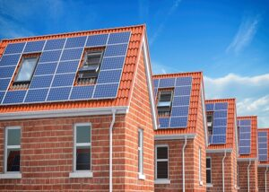 Row of house with solar panels on roof  on blue sky background. 3d illustration