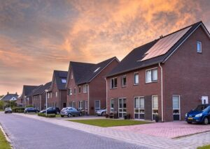 Street with modern family houses in urban suburb in the Netherlands