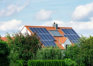 Modern house with photovoltaic solar cells on the roof and a thermal solar heating system for alternative energy production